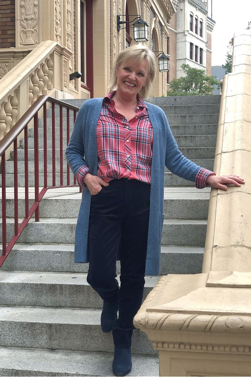 women on staircase wearing talbots sweater and plaid hirt