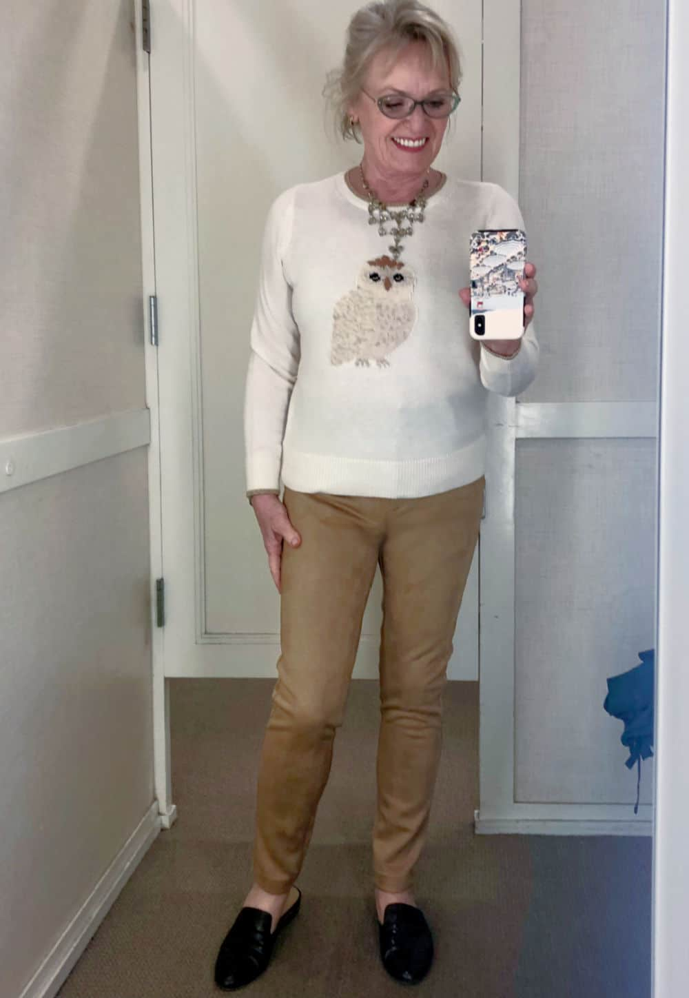 fashion blogger jennifer connolly wearing owl sweater and faux suede jeans in Loft changing room