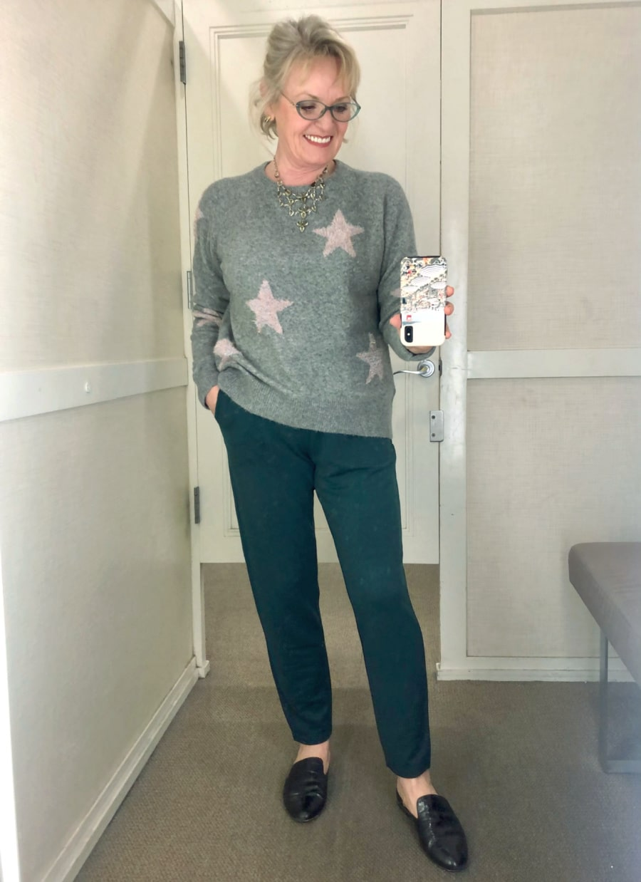 fashion blogger jennifer of a well styled life wearing star sweater and lou and grey pants in Loft changing room