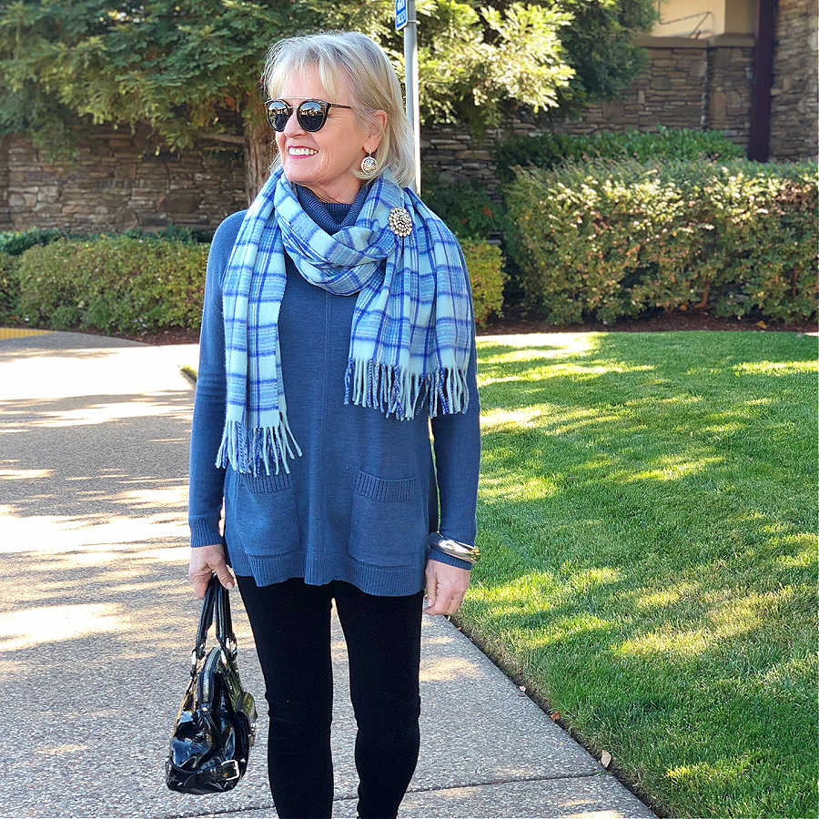 fashion blogger jennifer connolly of a well styled life wearing blue sweater tunic, plaid scarf and snowflake pin