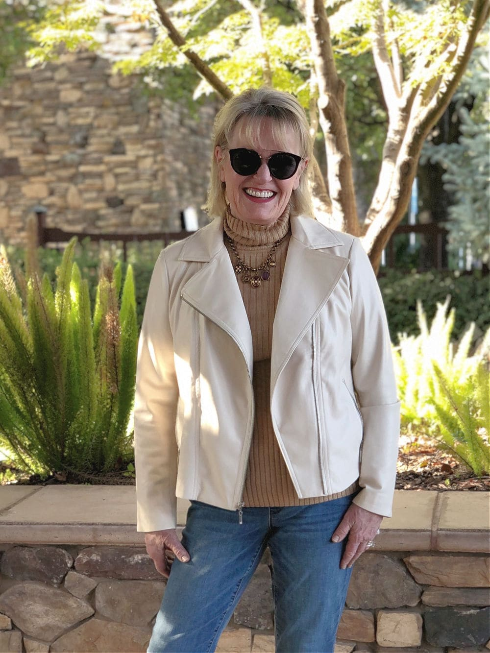 fashion blogger jennifer connolly of a well styled life wearing ivory jacket and camel sweater