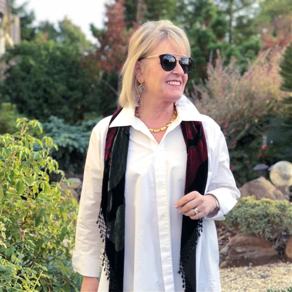 over 50 fashion blogger wearing dean davidson earrings and necklace with white shirt