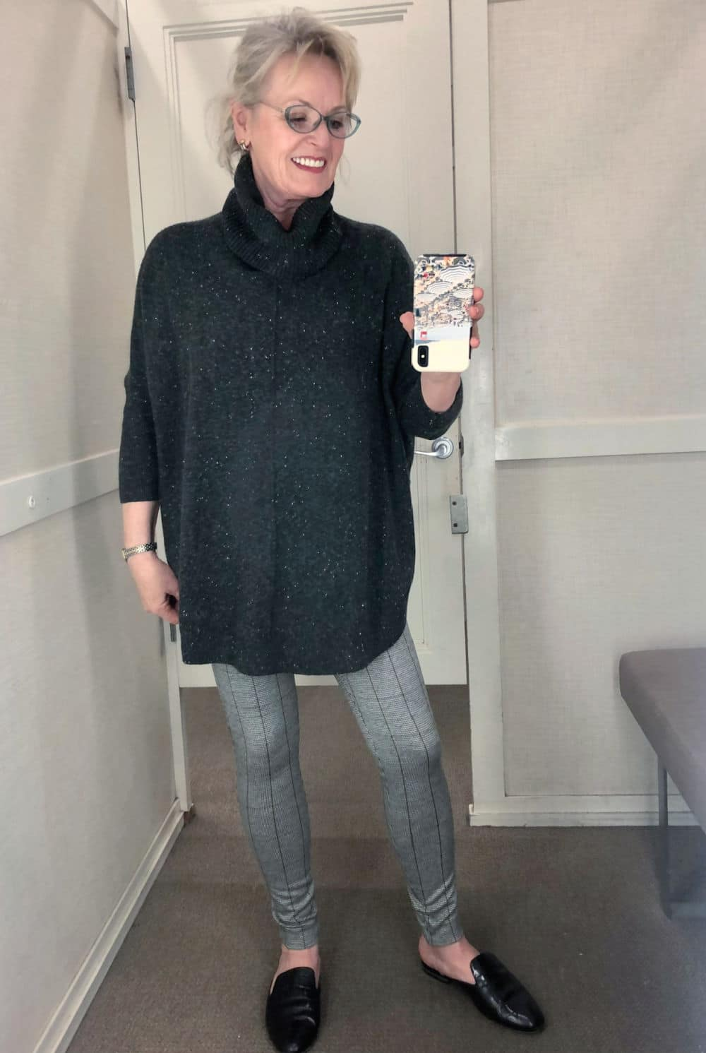 jennifer of a well styled life wearing flecked sweater and checked leggings in Loft dressing room