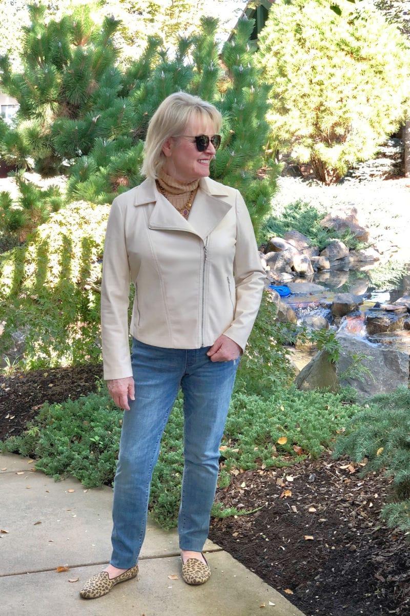 fashion blogger jennifer connolly wearing fauz leather jacket and camel turtleneck