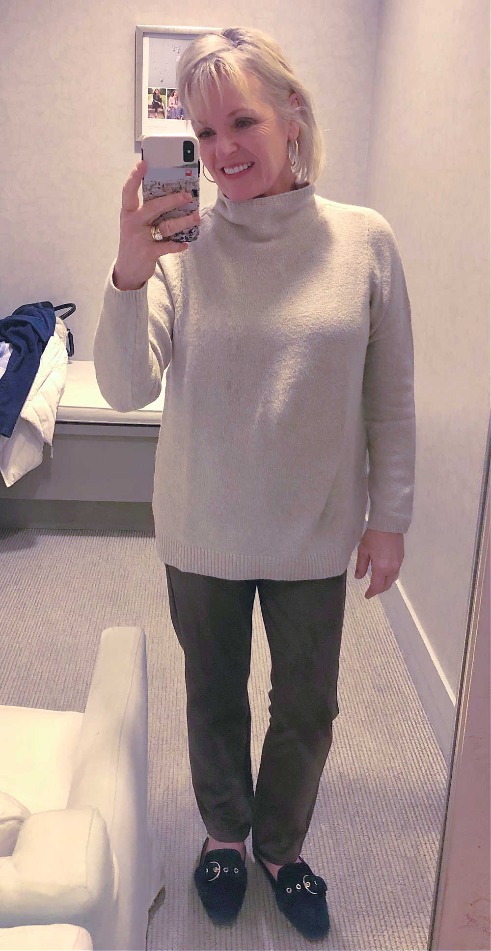 jennifer connolly of a well styled life in j. jill dressing room wearing beige sweater and taupe pants