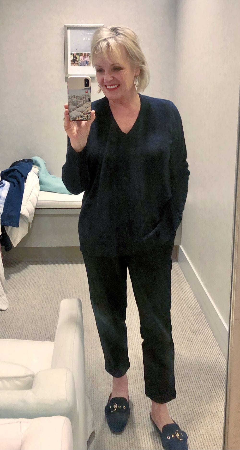 over 50 fashion blogger jennifer of a well styled life wearing blue sweater and black velvet leggings in j jill dressing room