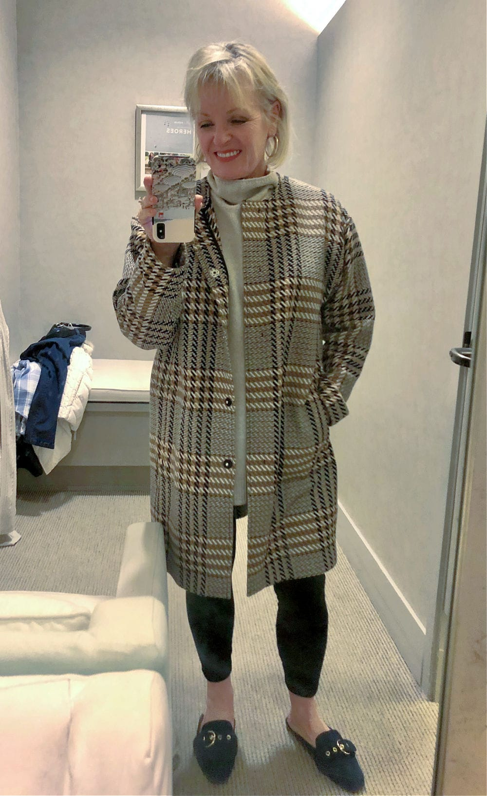 jennifer connolly wearing plaid coat, velour leggings and beige sweater in j jill dressing room