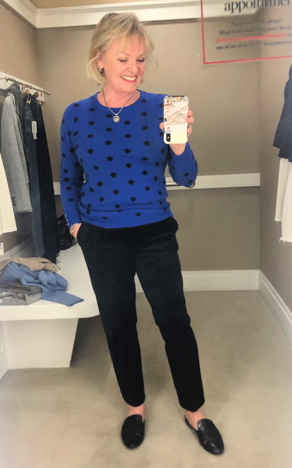jennifer connolly in talbots dressing room wearing blue polka dot sweater and black velveteen jeans