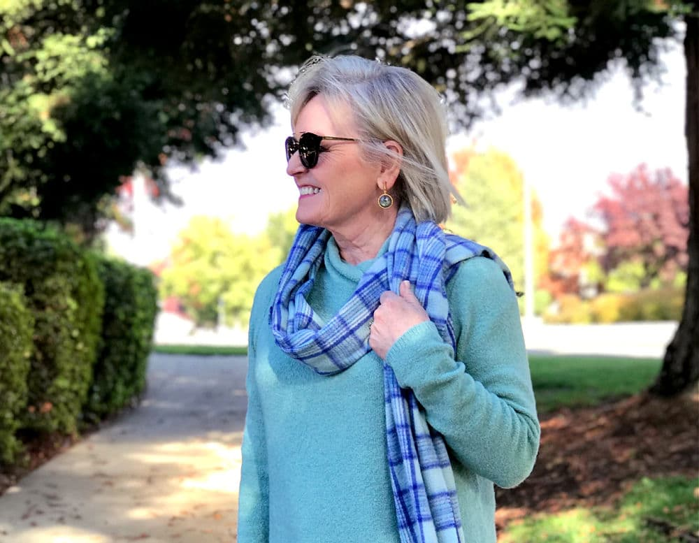 jennifer of a well styled life wearing dean davidson earrings plid scarf and aqua sweater