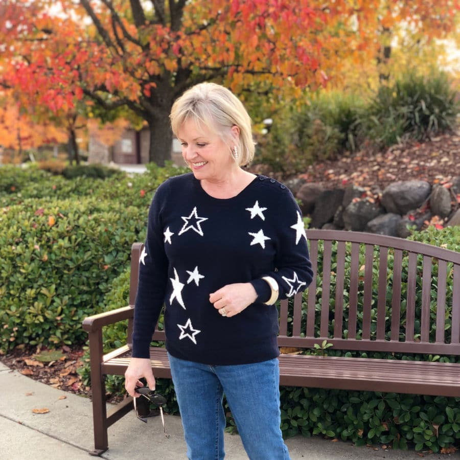 navy star sweater worn by jennifer connolly of a well styled life