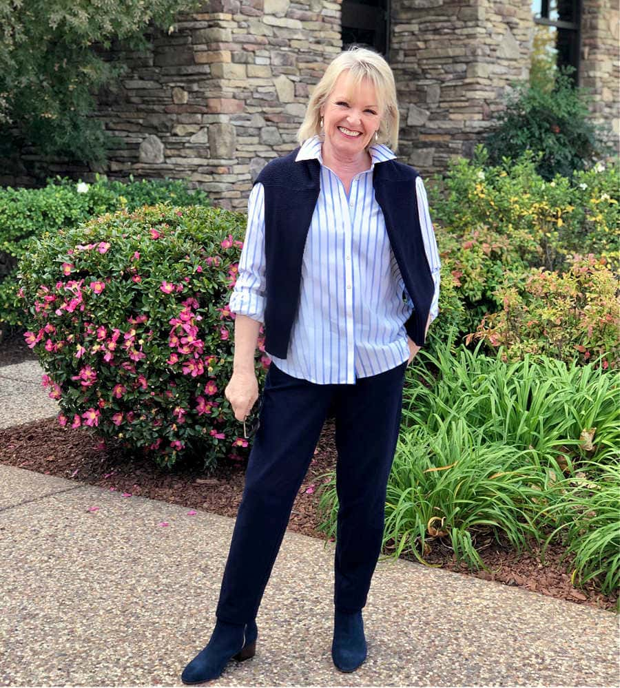 fashion blogger jennifer of a well styled life wearing talbots blue suede boots, navy sweater and navy T Talbots pants