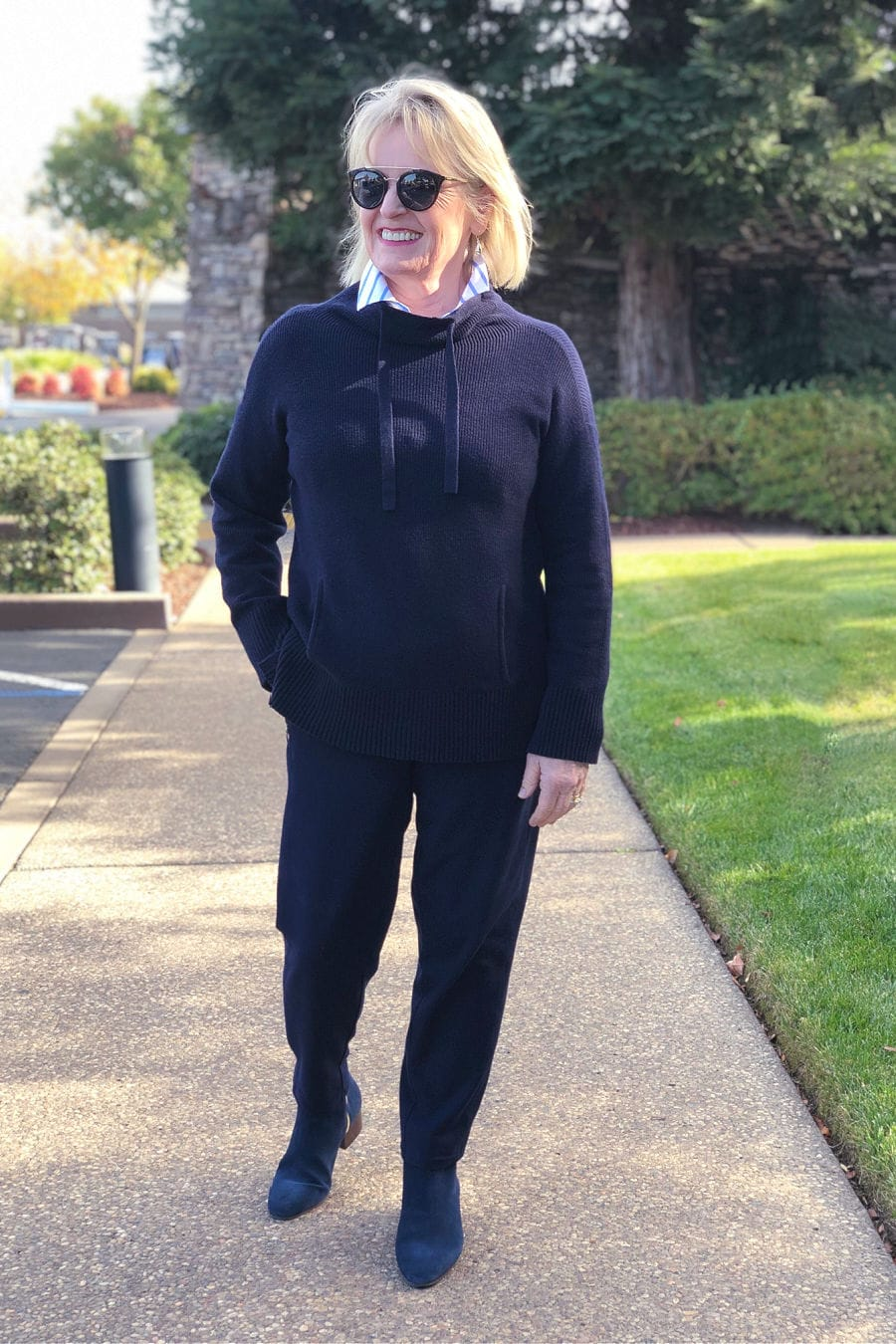over 50 fashion blogger jennifer connolly wearing navy talbots sweater, pants and boots