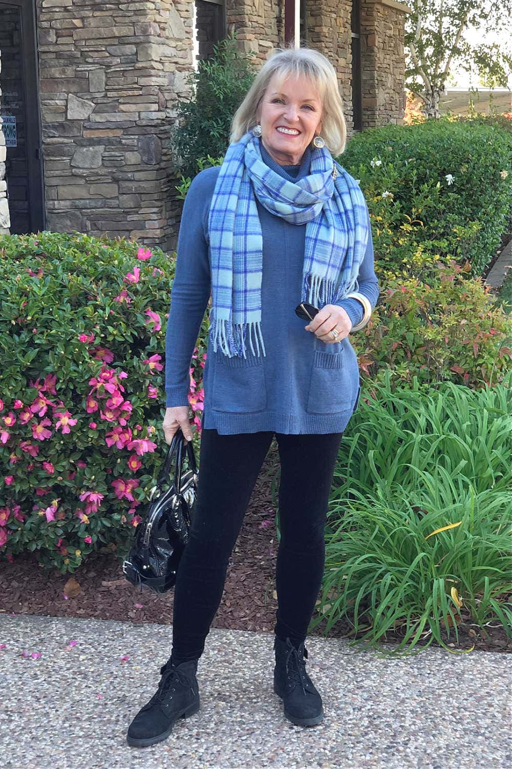 relaxed holiday outfit with velvet leggings, tunic sweater and plaid scarf on jennifer connolly of a well styled life