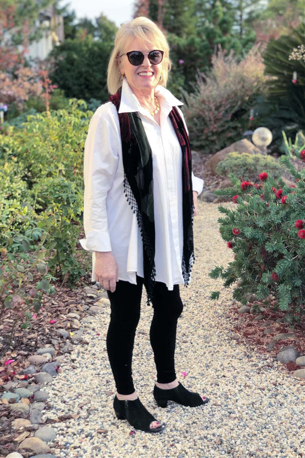 over 50 fashion blogger jennifer of a well styled life wearing casual holiday outfit with white tunic, velvet leggings and velvet scarf