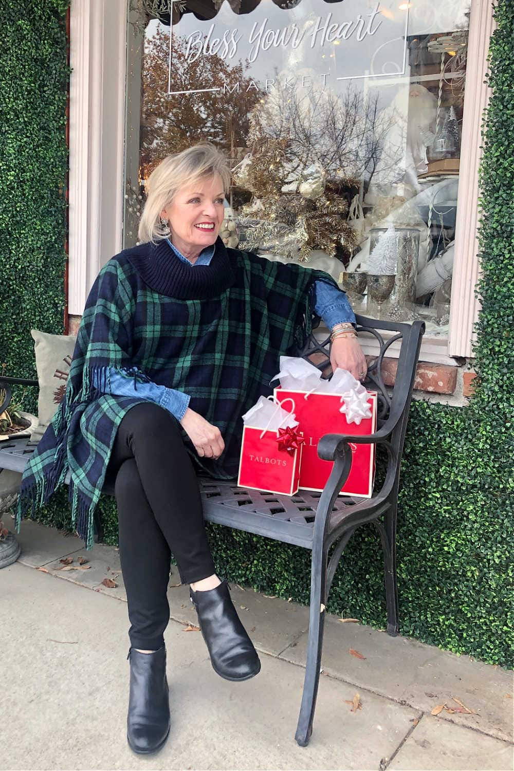 fashion blogger jennifer connolly of a well styled life sitting on bench wearing Talbots ribknit poncho