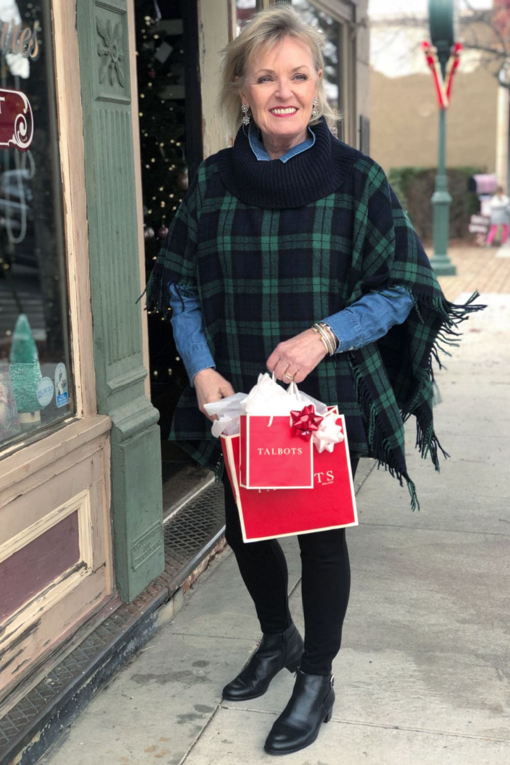 fashion blogger jennifer connolly of a well styled life wearing Talbots barely boots jeans with blackwatch plaid poncho