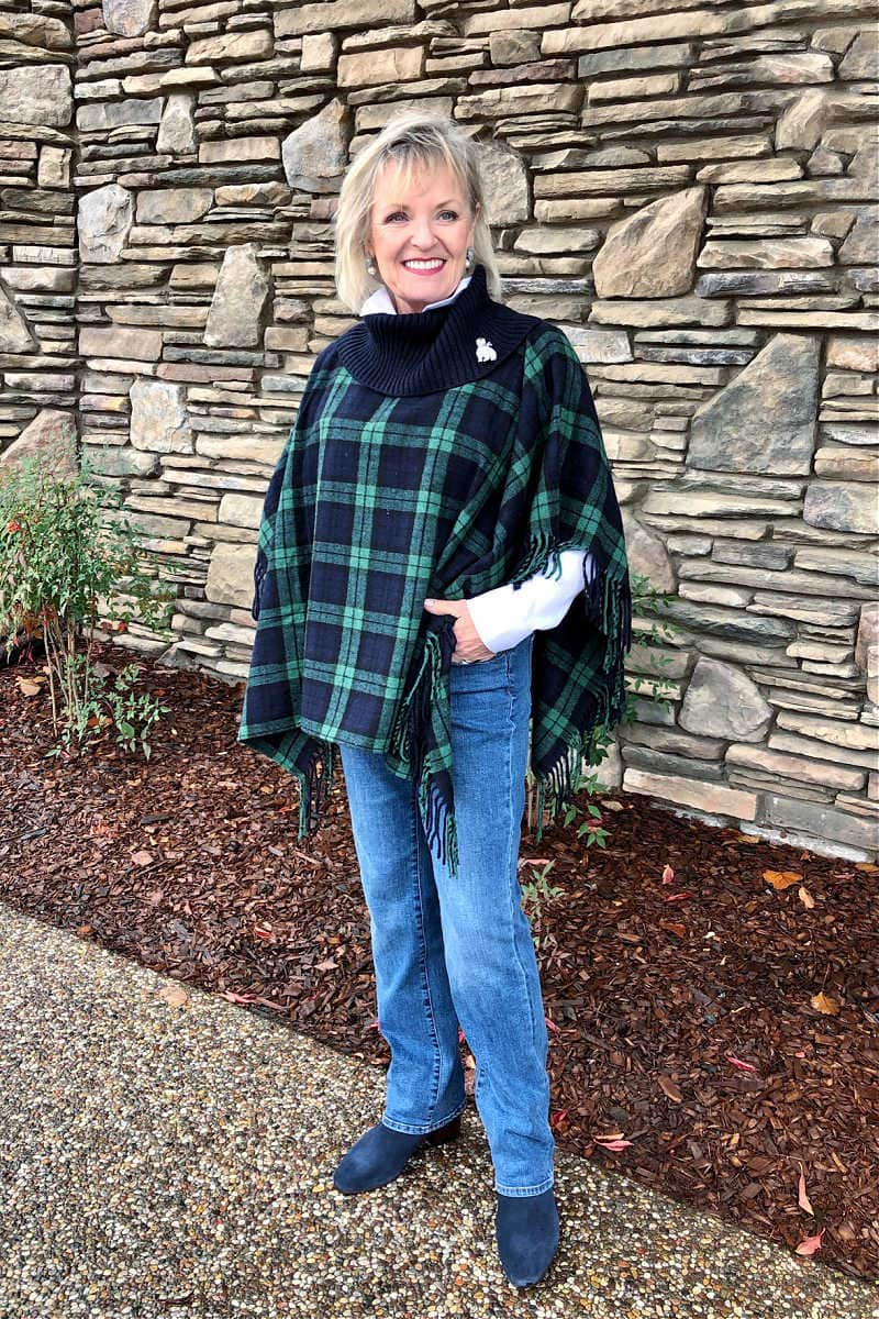 over 50 fashion blogger jennifer of a well styled life wearing blue jeans with black watch plaid poncho from Talbots