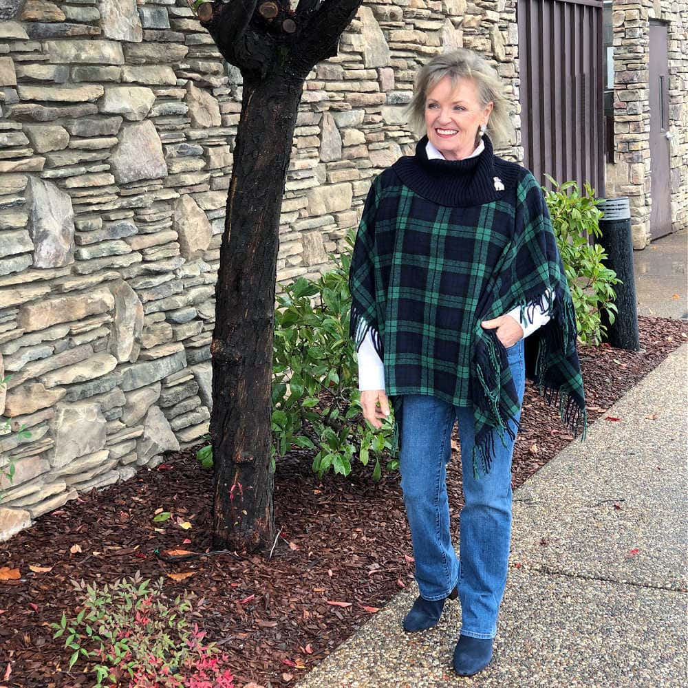 fashion blogger jennifer of a well styled life wearing talbots black watch plaid poncho and barely boot jeans