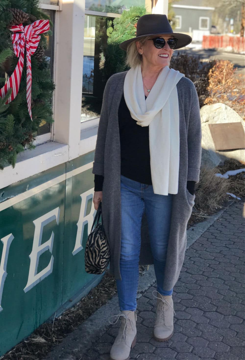 fashion blogger jennifer connolly wearing long gray cashmere sweater with gray fedora