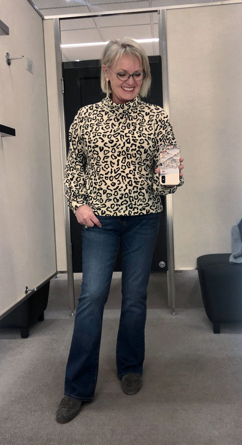 DRESSING ROOM PHOTO OF JENNIFER CONOLLY WEARING LEOPARD TOP