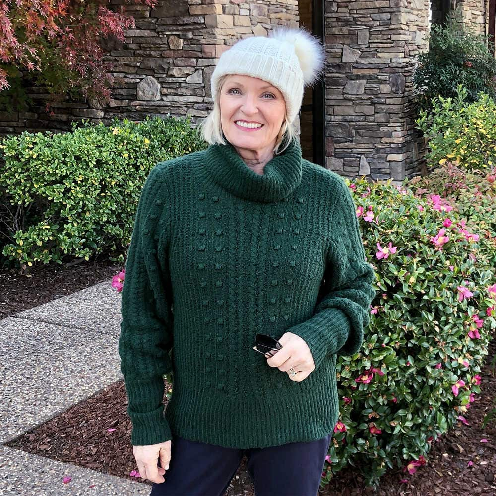 fashion blogger jennifer of a well styled life wearing green turtleneck and pom pom beanie from nordstrom