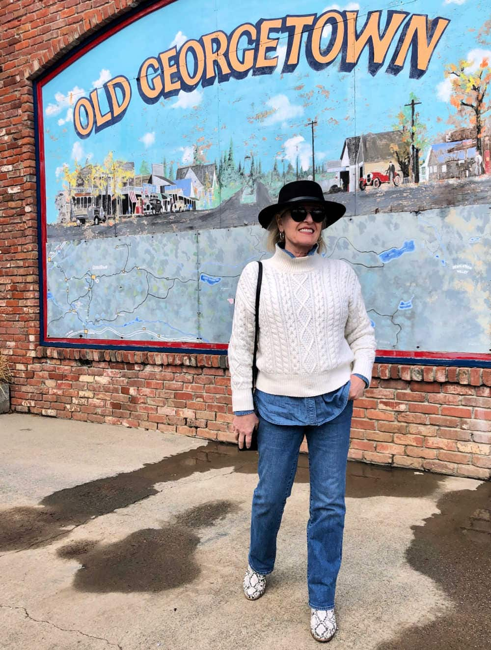 over 50 fashion blogger jennifer connolly of a well styled life wear black fedora, ivory cable sweater and boot cut jeans in Old Georgetown