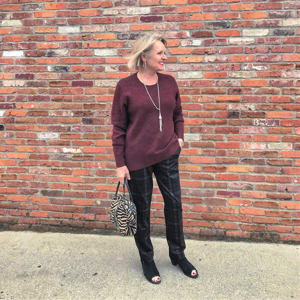 fashion blogger jennifer connolly wearing burgundy sweater and plaid pants by Liverpool los angeles