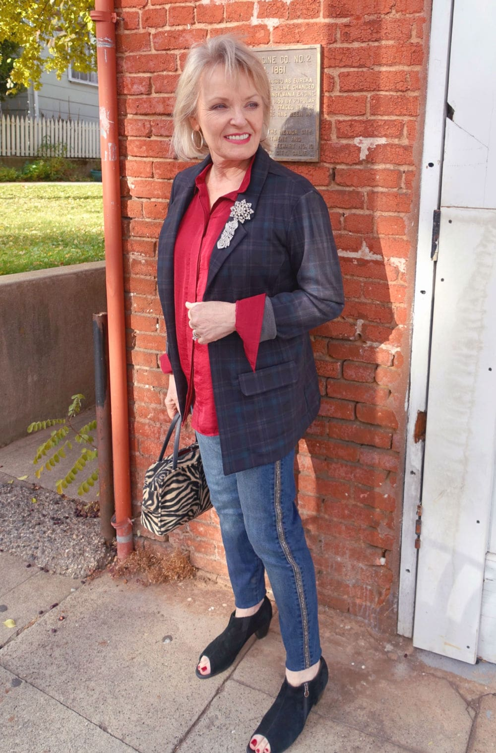 fashion blogger jennifer of a well styled life wearing red shirt and plaid blazer