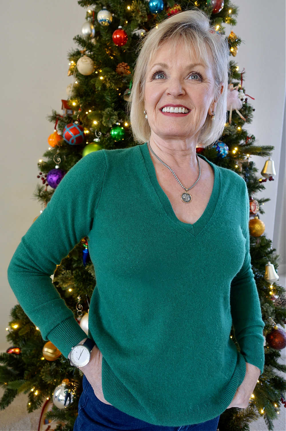 jennifer connolly of a well styled life wearing green sweater and nordgreen watch
