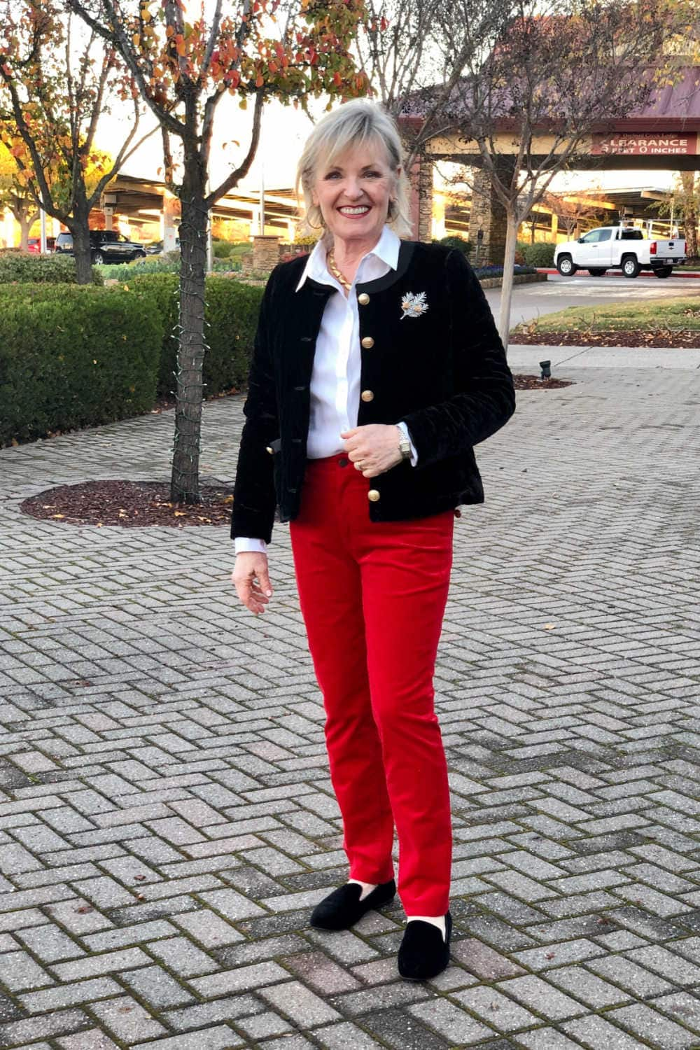 over 50 fashion blogger jennifer of a well styled life wearing talbots red pants and black jacket