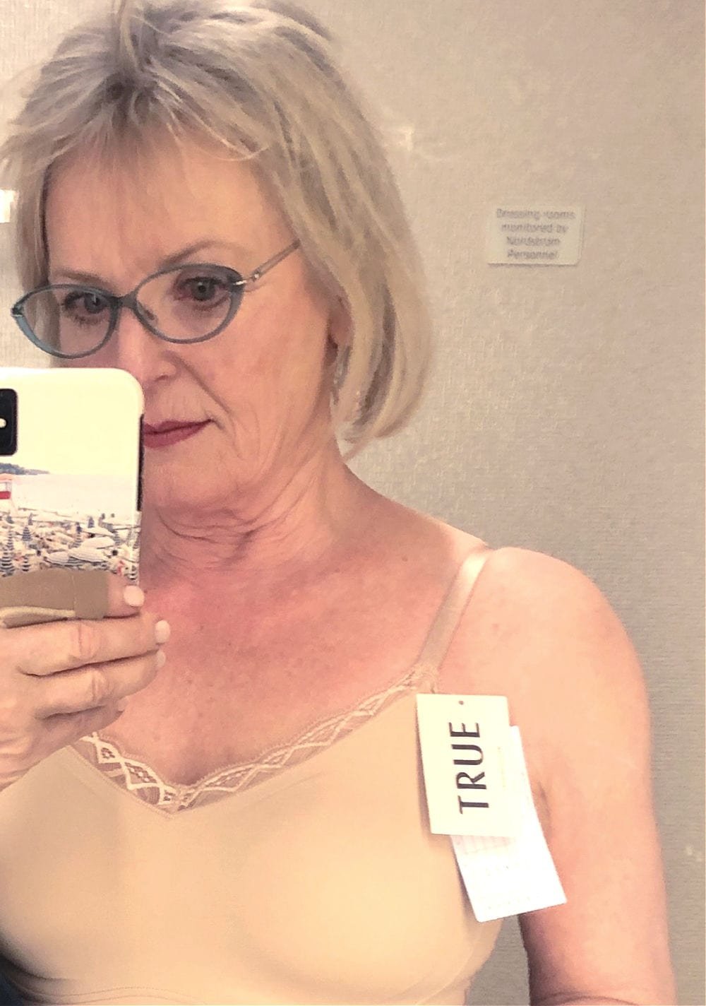 over 50 fashion blogger jennifer connolly of a well styled life wearing True wireless bra in Nordstrom dressing room