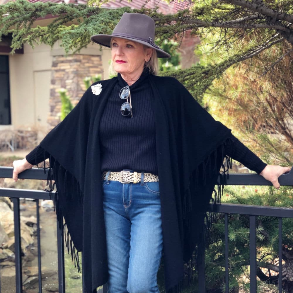 over 50 fashion blogger jennifer connolly wearign brixton hat, chicos cape and chicos jeans