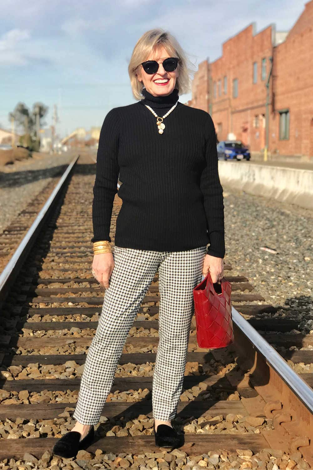 fashion blogger jennifer of a well styled life wearign chicos turtleneck and juliet pant