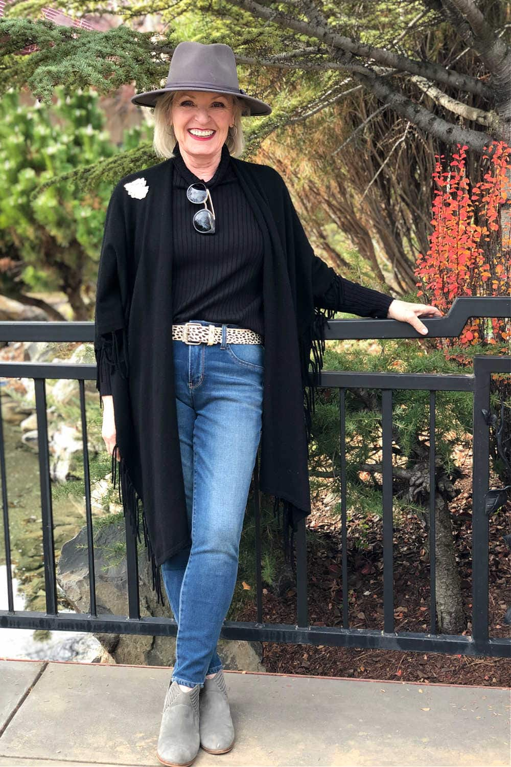 over 50 fashion blogger jennifer of a well styled life wearing grey fedora and black ruana