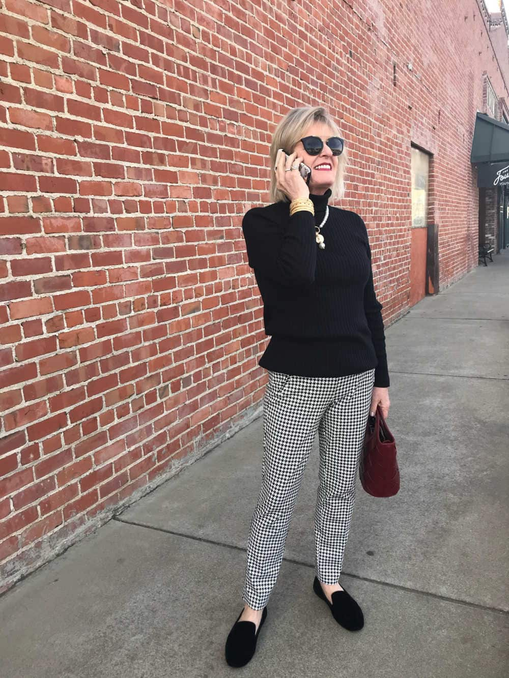 fashion blogger jennifer connolly wearing herringbone pants and turtleneck from chicos