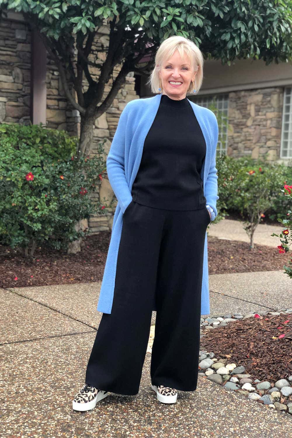 over 50 fashion blogger jennifer connolly wearing coatigan over black pants and top from Banana Republic
