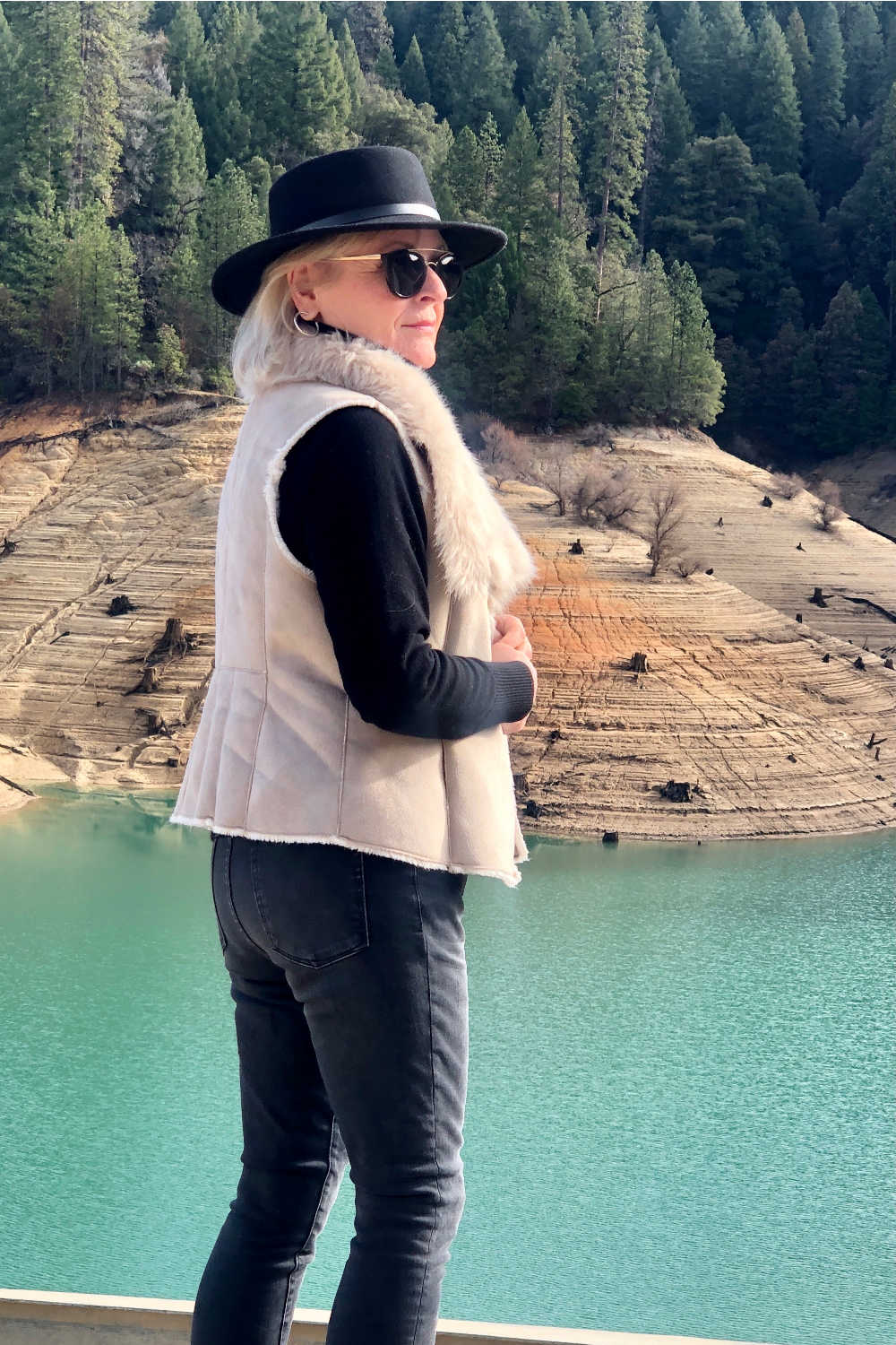 fashion blogger jennifer connolly of a well styled life wearing black hat and nic + zoe faux fur vest