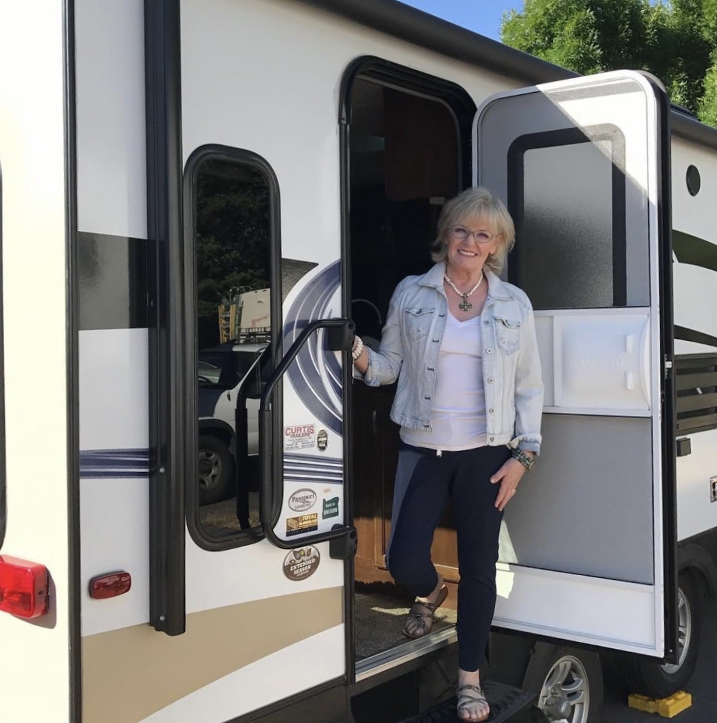 fashion blogger jennifer connolly of a well styled life in doorway of travel trailer