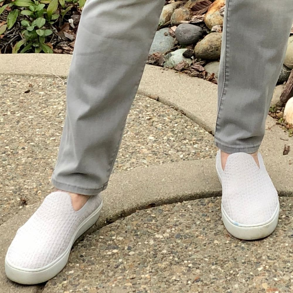 pale gray rothys sneakers on a well styled life