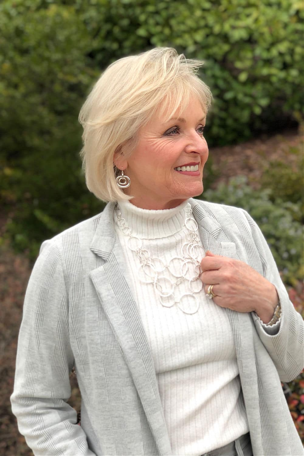 midlife blogger jennifer of a well styled life wearing Chico's gray jacket with silver jewelry