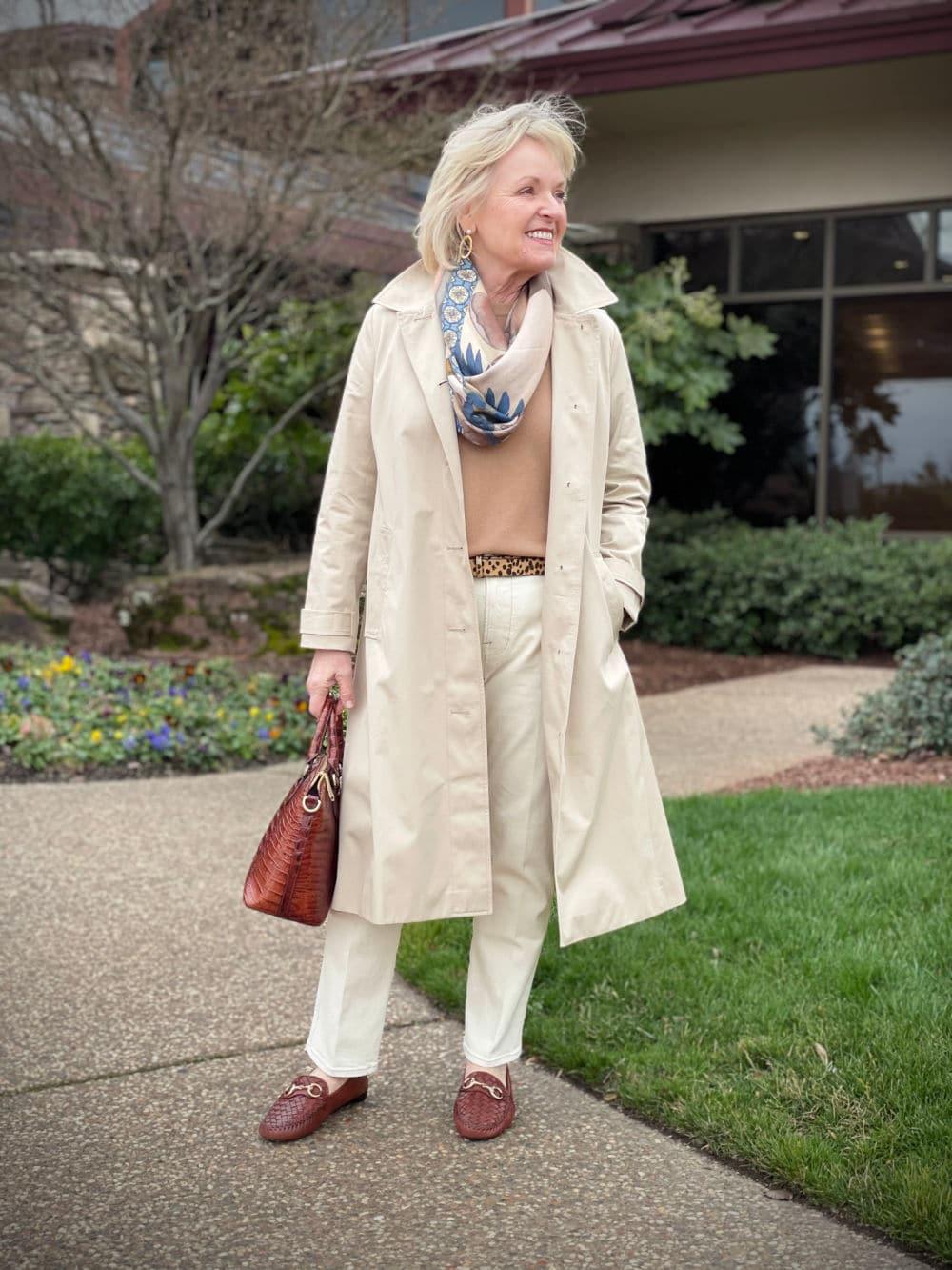 neutral outfit worn under beige raincoat