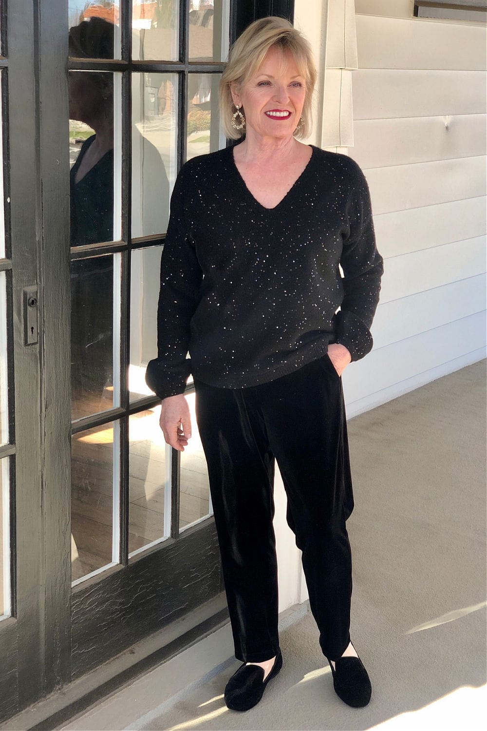 woman wearing black sweater pants and shoes