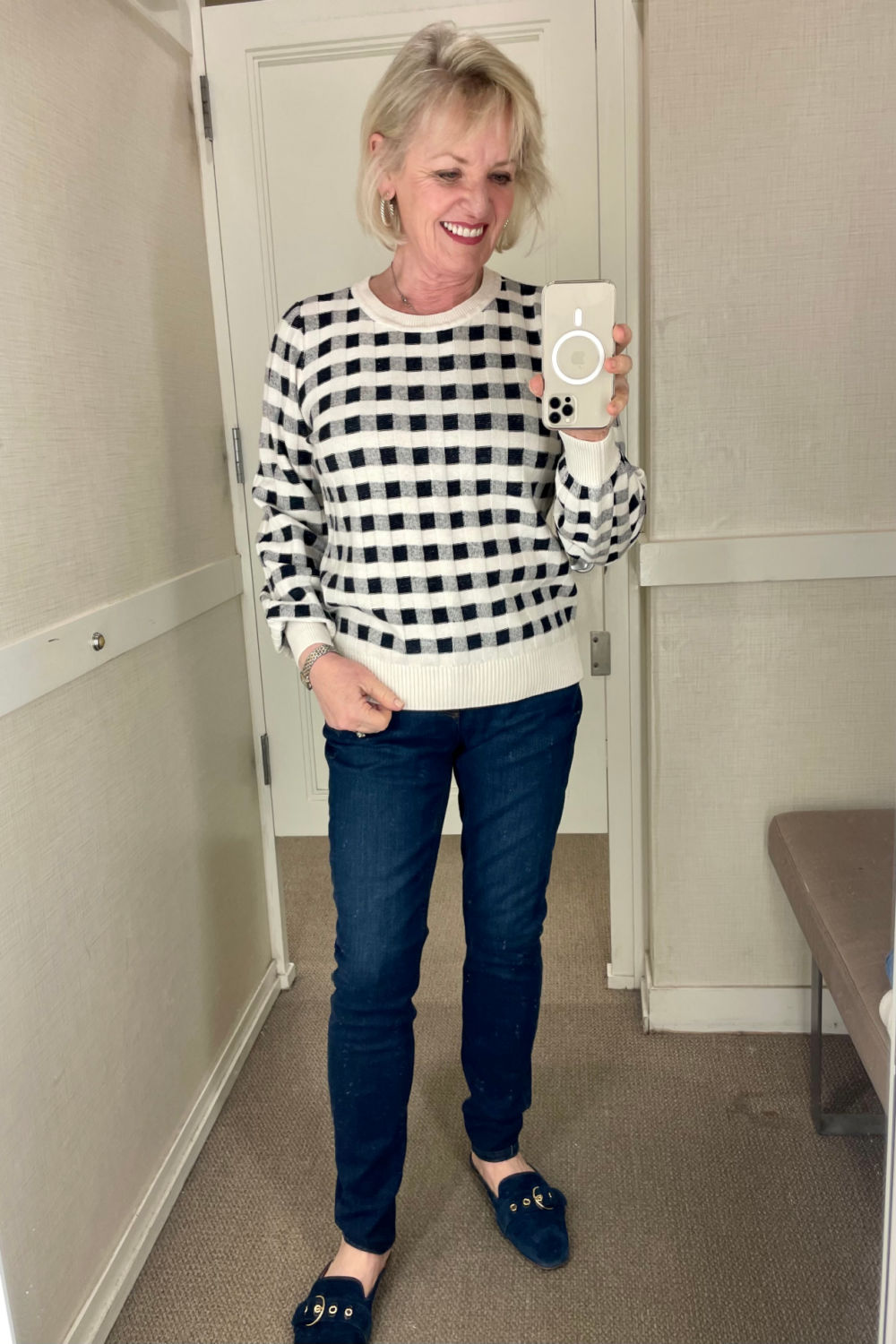 jennifer of a well styled life wearing navy gingham sweater and deep blue jeans at loft store