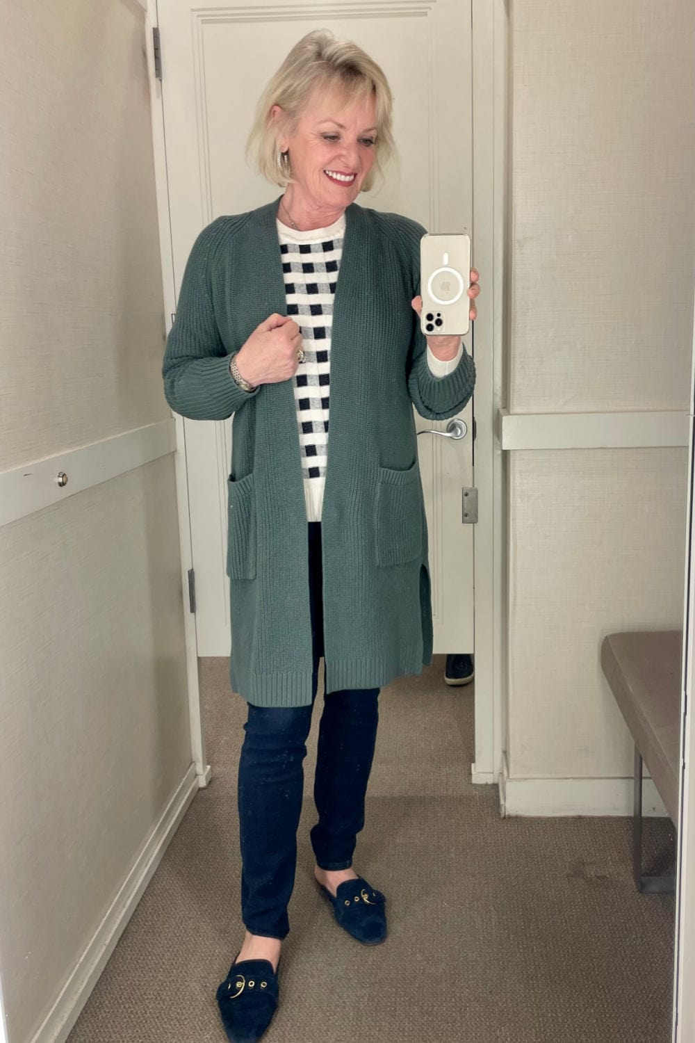 lou and grey teal cotton cardigan on woman in dressing room mirrror