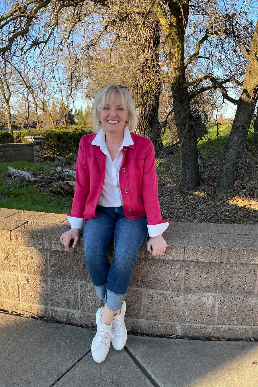 over 50 fashion blogger sgtyling Chico's raspberry faux suede jacket with cuffed jeans and white sneakers