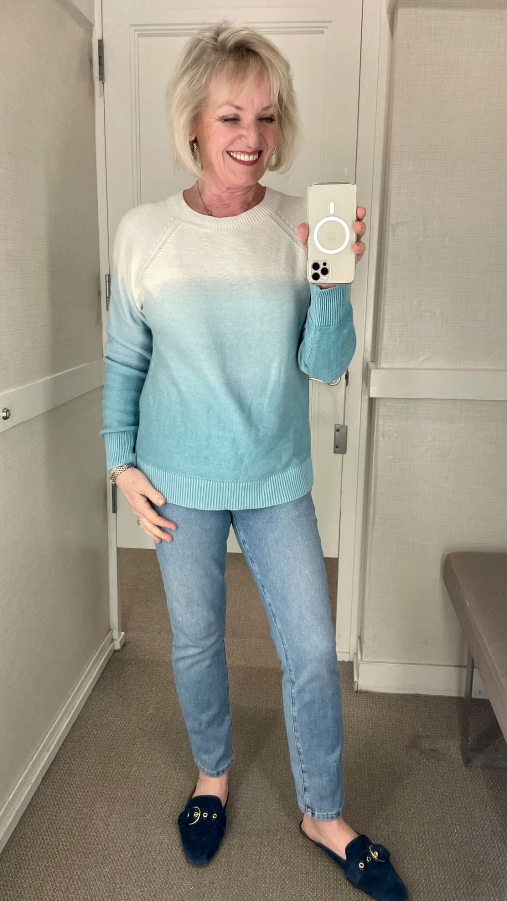 ombre sweater in pale blue spring color and pale blue jeans on woman at loft changing room