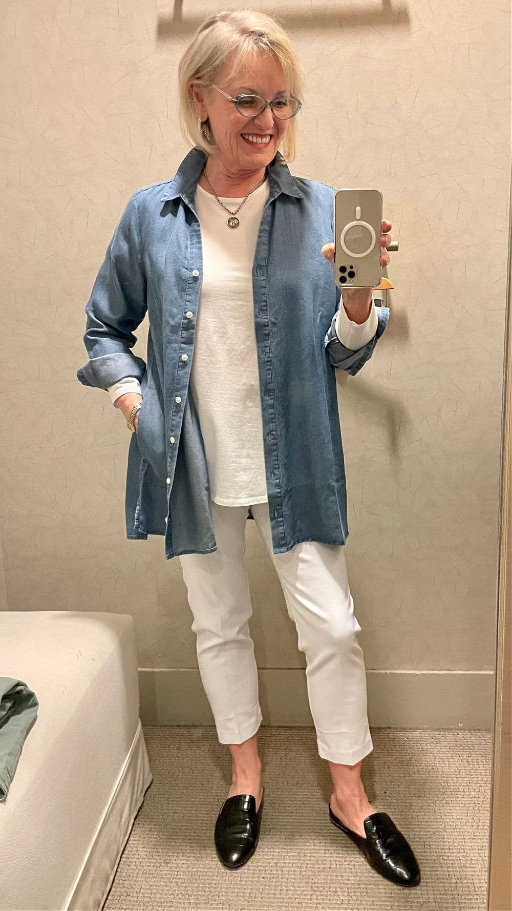jennifer of a well styled life wearinf denim shirt with white jeans and top