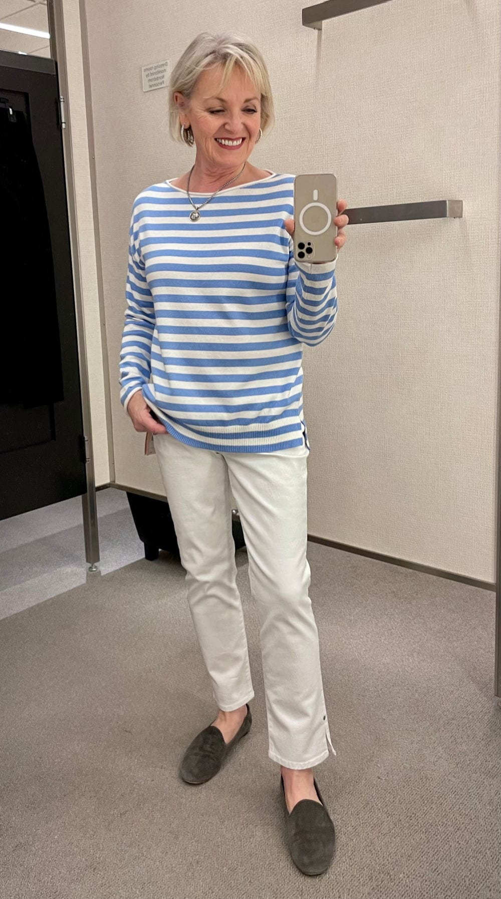 WOMAN WEARING BLUE AND WHITE STRIPE SHIRT AND WHITE CROP JEANS
