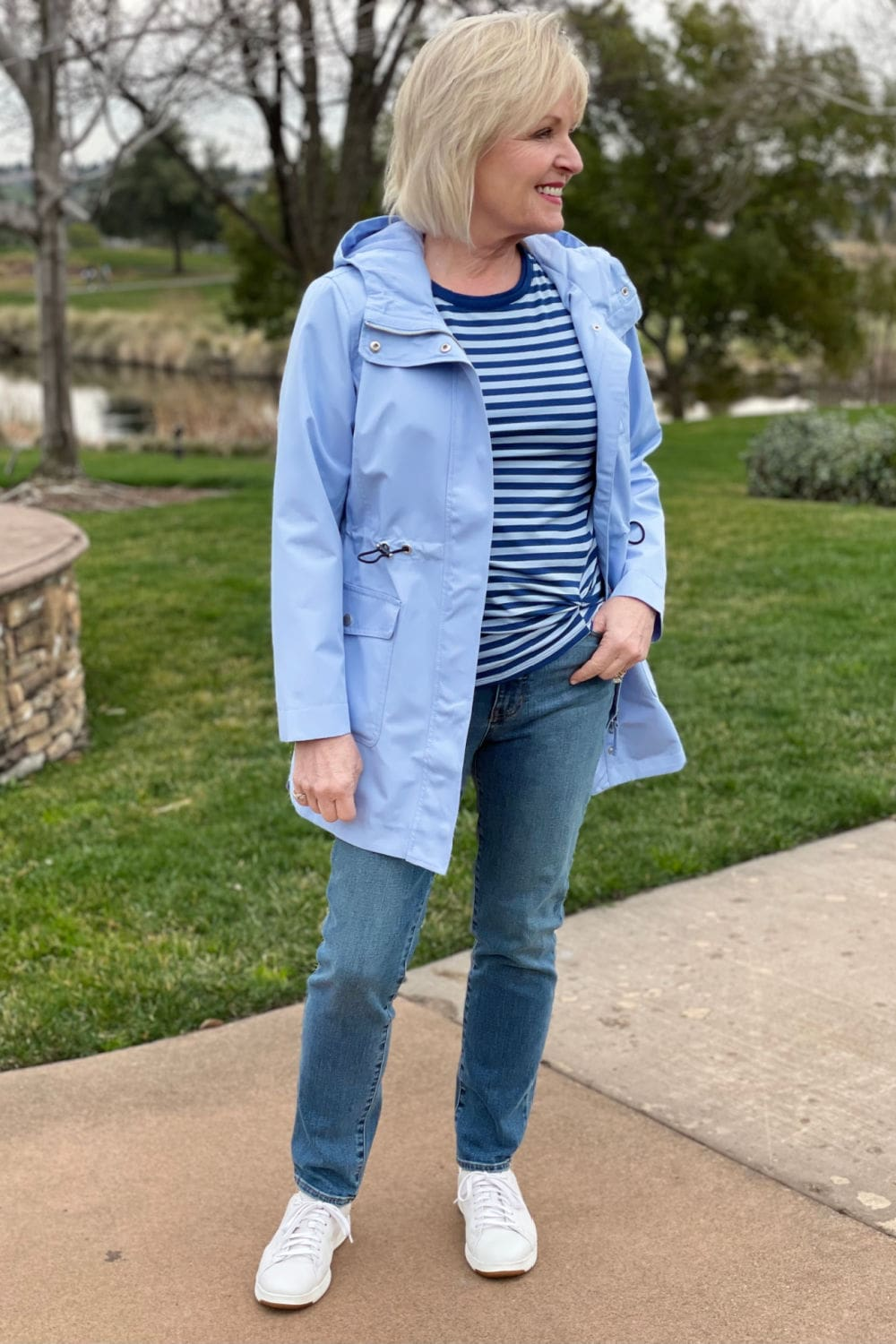 woman wearing blue stried top, blue jeans, and blue coat