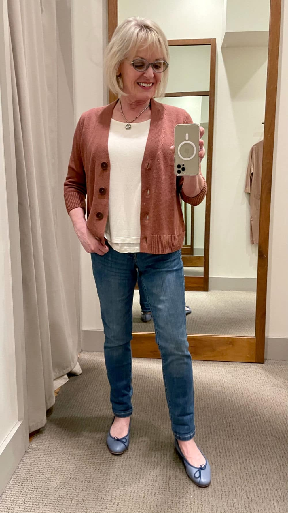 over 50 blogger wearing cropped cardigan and jeans in dressing room